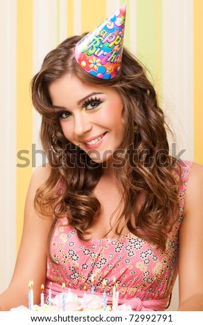 closeup portrait of attractive teenage girl celebrating her birthday - stock photo