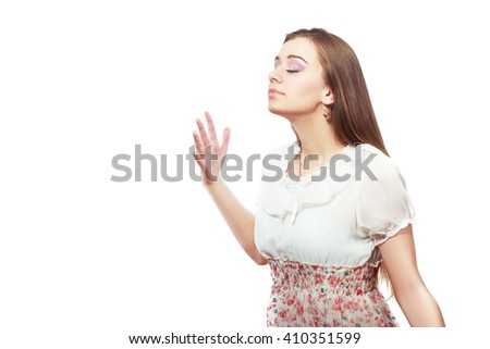 Closeup portrait of attractive woman wafting air to nostrils to smell better, isolated on white background