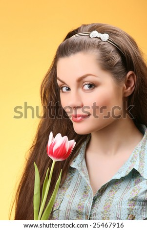 closeup portrait of attractive woman with tulip