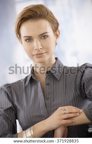 Closeup portrait of attractive young businesswoman, looking at camera. - stock photo
