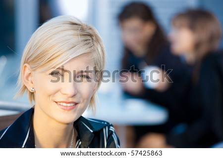 Closeup portrait of attractive young businesswoman, smiling. - stock photo