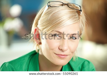Closeup portrait of attractive young businesswoman wearing green shirt, smiling. - stock photo