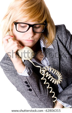 closeup portrait of attractive young businesswoman with phone on white background - stock photo