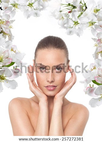 closeup portrait of attractive young  caucasian  woman brunette isolated on white studio shot lips face head and shoulders looking at camera spring flowers - stock photo
