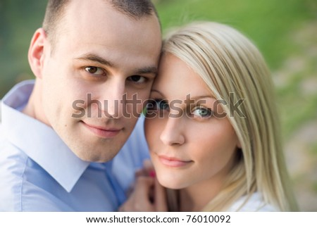 Closeup portrait of attractive young couple having fun outdoors- - stock photo