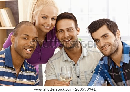 Closeup portrait of attractive young friends smiling happy, looking at camera. - stock photo