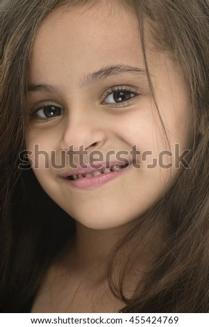Closeup Portrait of Attractive Young Girl With Beautiful Smile Isolated on White Background - stock photo