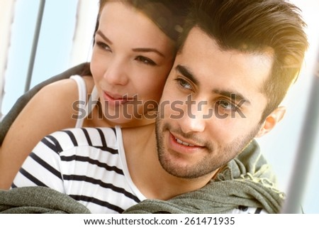 Closeup portrait of attractive young loving couple embracing on sailing boat. - stock photo