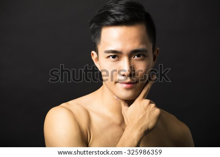 Closeup portrait of attractive young man face - stock photo