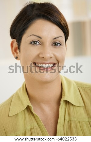 Closeup portrait of attractive young woman, smiling happily.? - stock photo