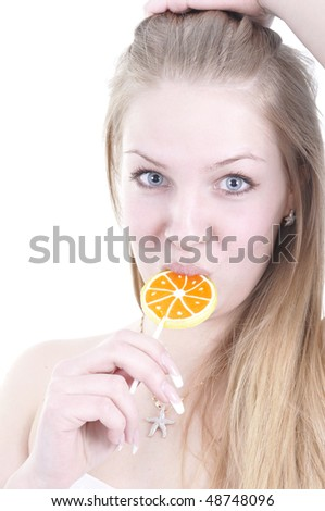 Closeup portrait of attractive young woman with lollipop. Isolated.