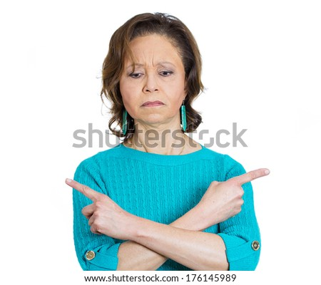 Closeup portrait of baffled senior mature woman pointing in opposite directions not sure where to go, what to do next in life, isolated on white background. Negative emotion facial expression feelings - stock photo