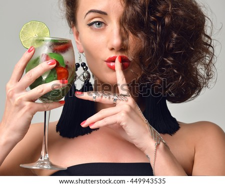 Closeup portrait of Bartender woman with mint and strawberry mojito margarita cocktail in hand making tss quiet sign isolated on a white background
