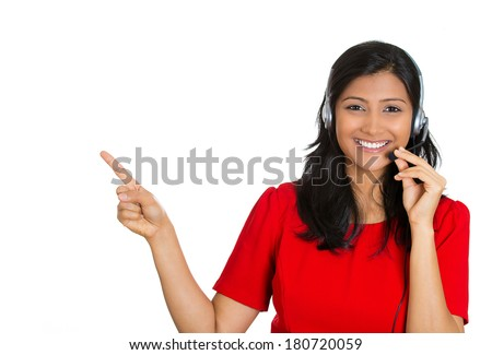 Closeup portrait of beautiful, adorable smiling female customer representative with phone headset pointing at copy space isolated on white background. Positive human emotions, facial expressions - stock photo