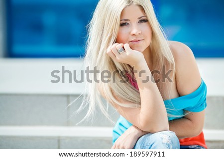 Closeup portrait of beautiful blonde woman in the city at summer time. Outdoors - stock photo