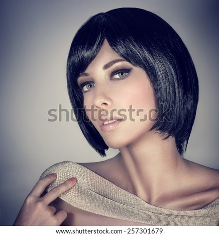 Closeup portrait of beautiful brunette female with stylish short haircut and makeup isolated on gray background, fashion and beauty concept - stock photo