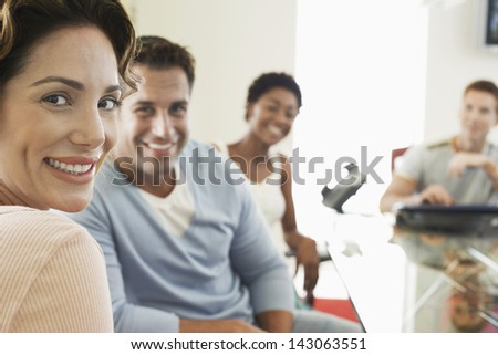 Closeup portrait of beautiful businesswoman with colleagues in conference room - stock photo