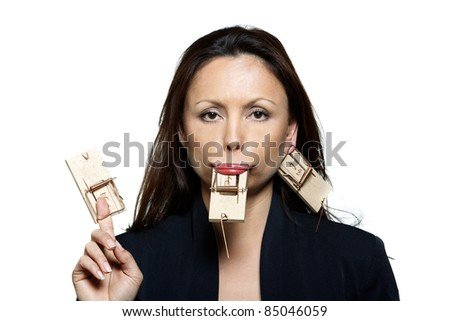 Closeup portrait of beautiful expressive woman with mouse traps in studio isolated on white background - stock photo