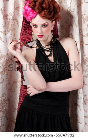 Closeup portrait of beautiful fashion woman posing with silck fabric.