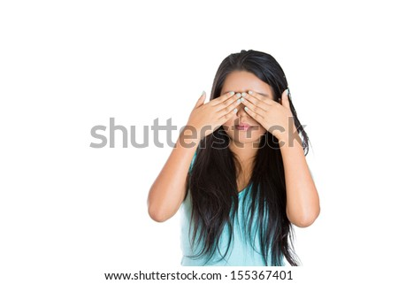 Closeup portrait of beautiful female closing eyes with hands, isolated on white background. See no evil concept. - stock photo