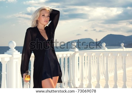 Closeup portrait of beautiful female model with a glass of wine - stock photo