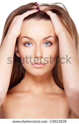 Closeup portrait of beautiful female model with blue eyes on white - stock photo