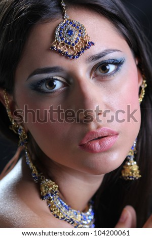 Closeup portrait of beautiful female wearing traditional indian