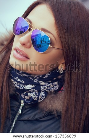 Closeup portrait of beautiful girl in sunglasses, outdoors - stock photo