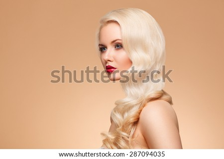 closeup portrait of beautiful girl with bright make-up and long blonde curls - stock photo