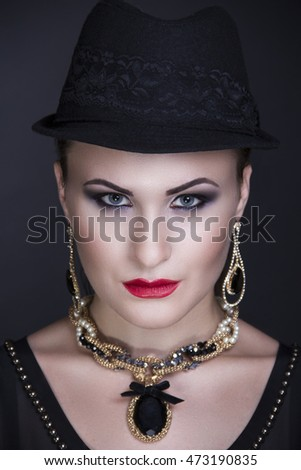 Closeup portrait of beautiful girl woman lady with make up studio styling. Luxury makeup Bright black shadows shiny red mat lipstick. New Professional photo exclusive model vip person, dark background