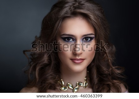 Closeup portrait of beautiful girl woman lady with volume combed hair styling. Luxury brunette curly hair. Bright dark makeup, tender lipstick. Professional photo model vip person. Hollywood stranded