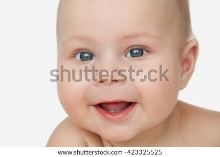 Closeup portrait of beautiful happy baby with first tooth isolated on a white background - stock photo