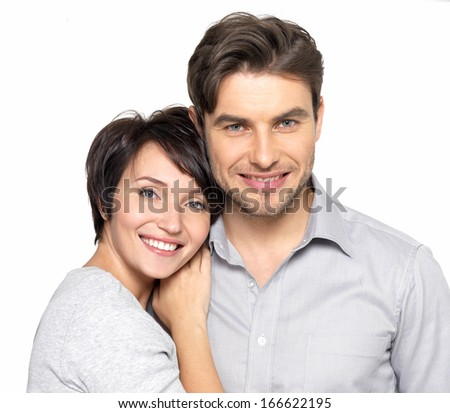 Closeup portrait of  beautiful happy couple isolated on white background. Attractive man and woman being playful. - stock photo