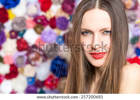 Closeup portrait of beautiful sexy summer woman over flower background. copy space. shallow depth of view, focus on eyes - stock photo