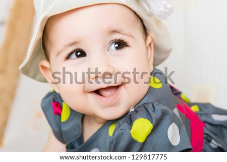 Closeup portrait of beautiful smiling baby girl in hat