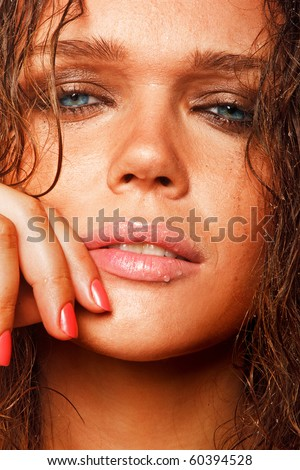 closeup portrait of beautiful wet woman with sun tan looking at camera - stock photo