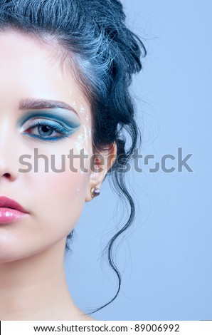 Closeup portrait of beautiful woman face with winter style makeup - stock photo