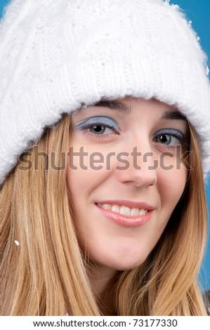 Closeup portrait of beautiful woman in winter hat - stock photo