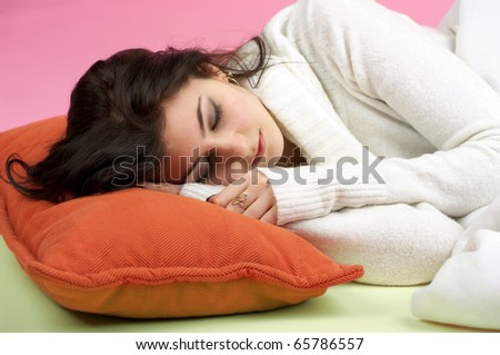 Closeup portrait of beautiful woman sleeping in the bed - stock photo