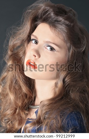 Closeup portrait of beautiful woman with amazing hairstyle and red lips in studio - stock photo