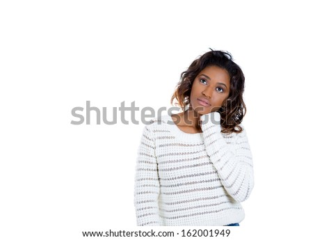 Closeup portrait of beautiful woman with fist on chin thinking about something that is making her sad looking upwards, isolated on white background with copy space. Negative human emotions  - stock photo