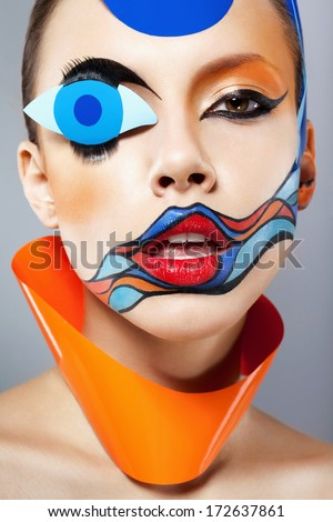 Closeup portrait of beautiful woman with painted art makeup and carnival decoration. Natural beauty, clean fresh skin. Looking at camera. Inside - stock photo