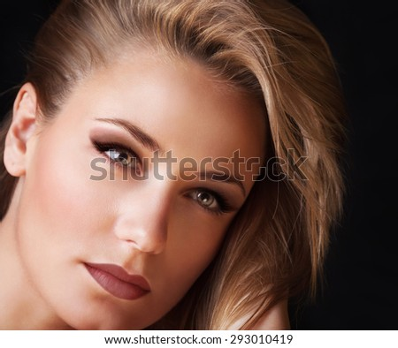 Closeup portrait of beautiful woman with perfect stylish makeup isolated on black background, attractive model after beauty salon - stock photo