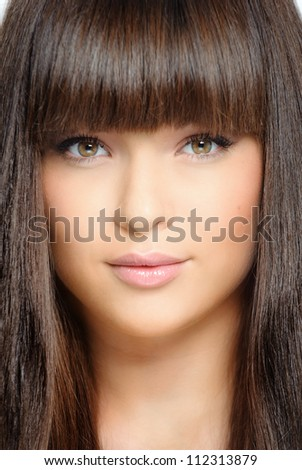 Closeup portrait of beautiful woman with straight long hair