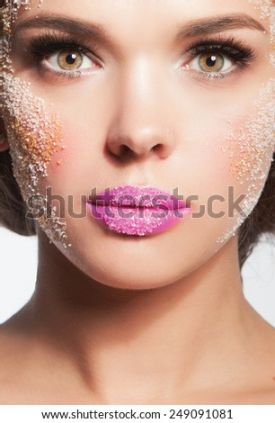 Closeup portrait of beautiful woman with white sugar on her face - stock photo