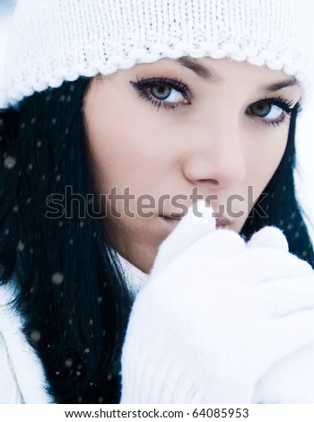 Closeup portrait of beautiful young girl in winter day - stock photo