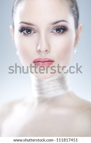 Closeup portrait of beautiful young woman giving the camera a sharp look of intelligence on white background - stock photo