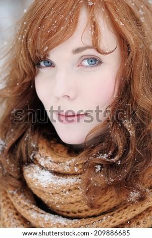 Closeup portrait of beautiful young woman in winter - stock photo