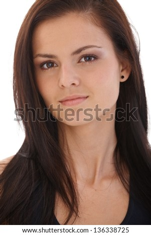 Closeup portrait of beautiful young woman looking at camera. - stock photo