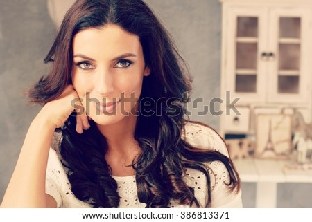 Closeup portrait of beautiful young woman looking at camera. - stock photo